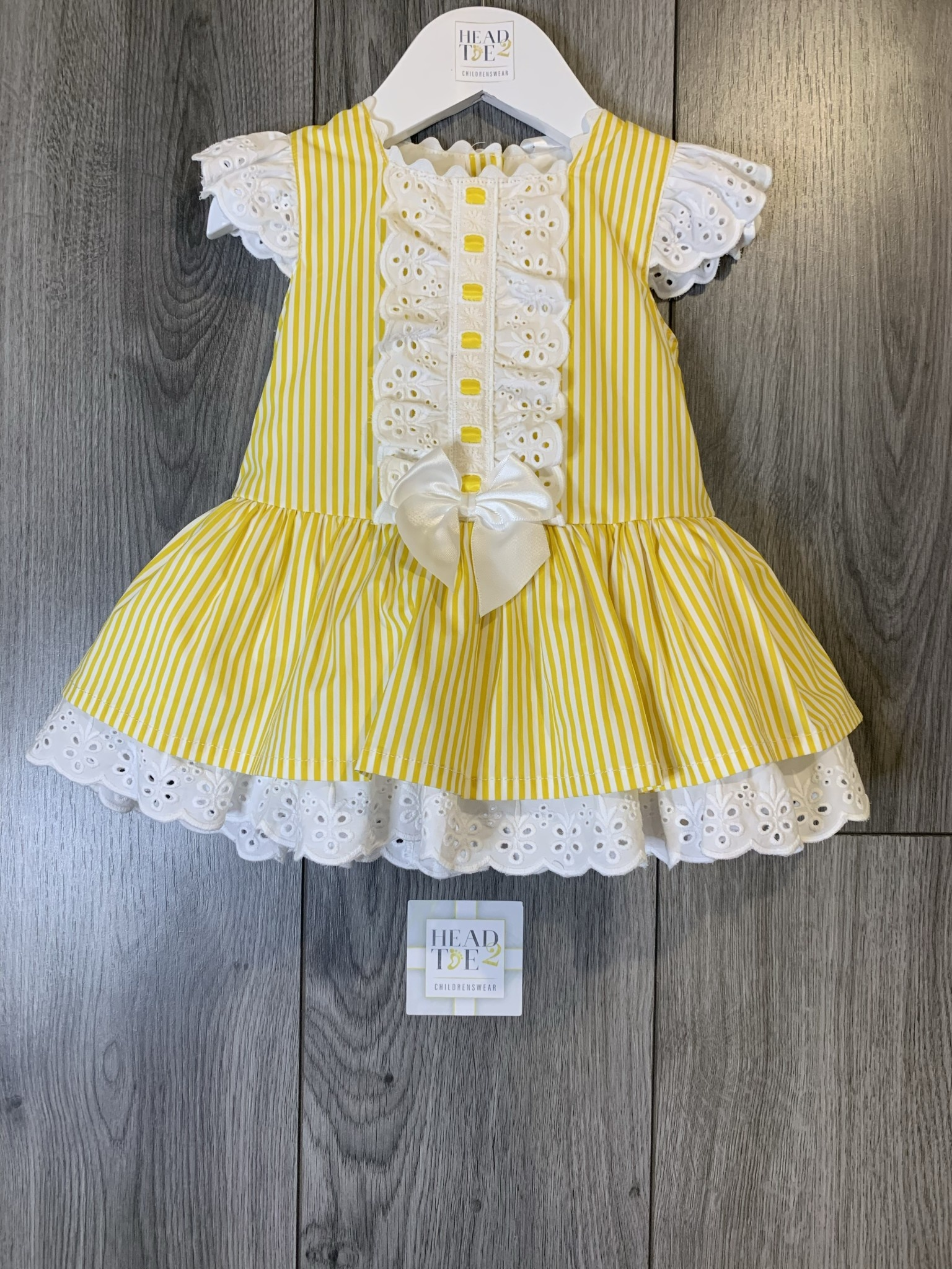 Spanish Yellow striped dress with middle bow detail 1904