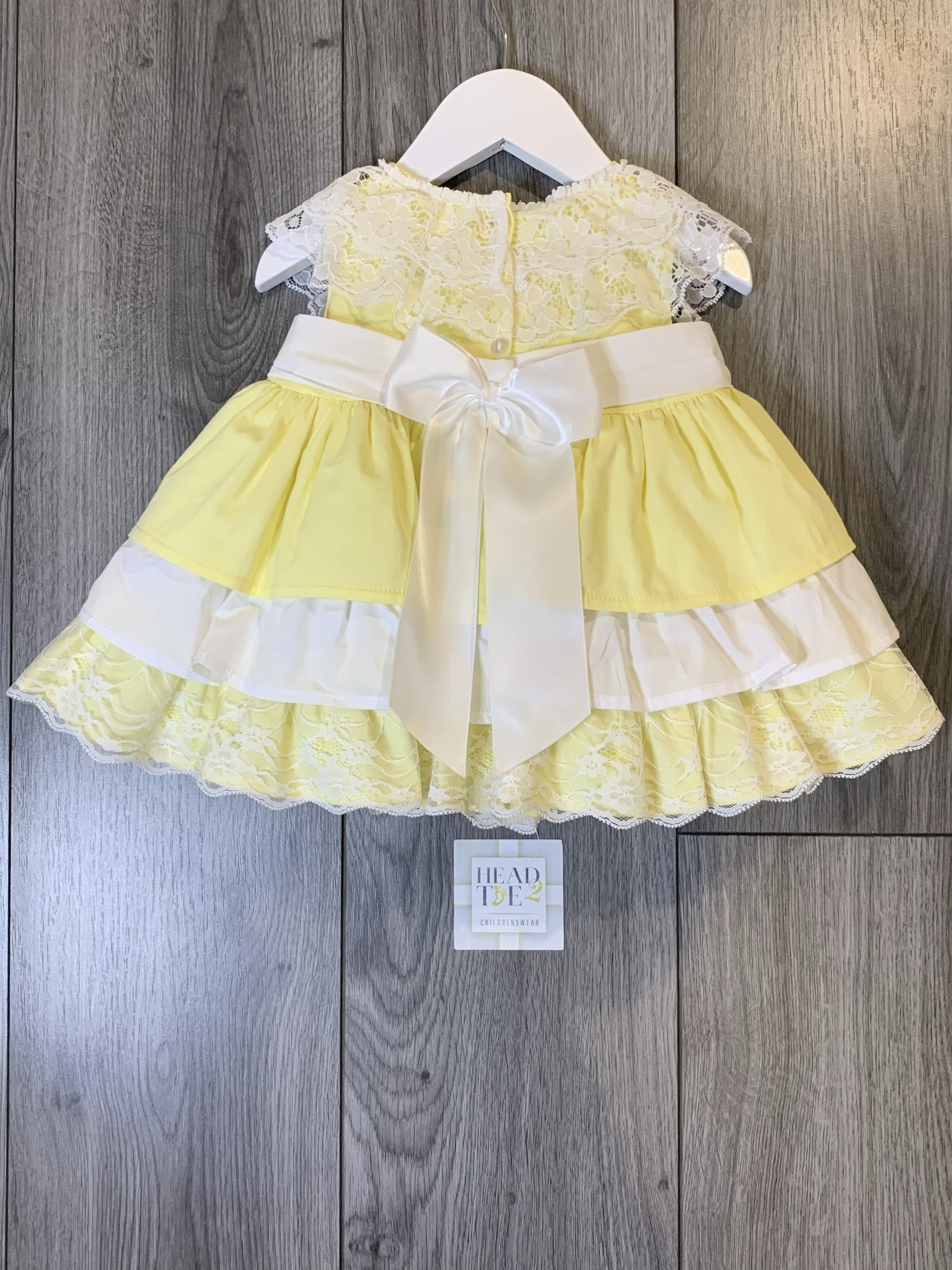 Spanish Lemon and white puff dress with bow frill detail 2013