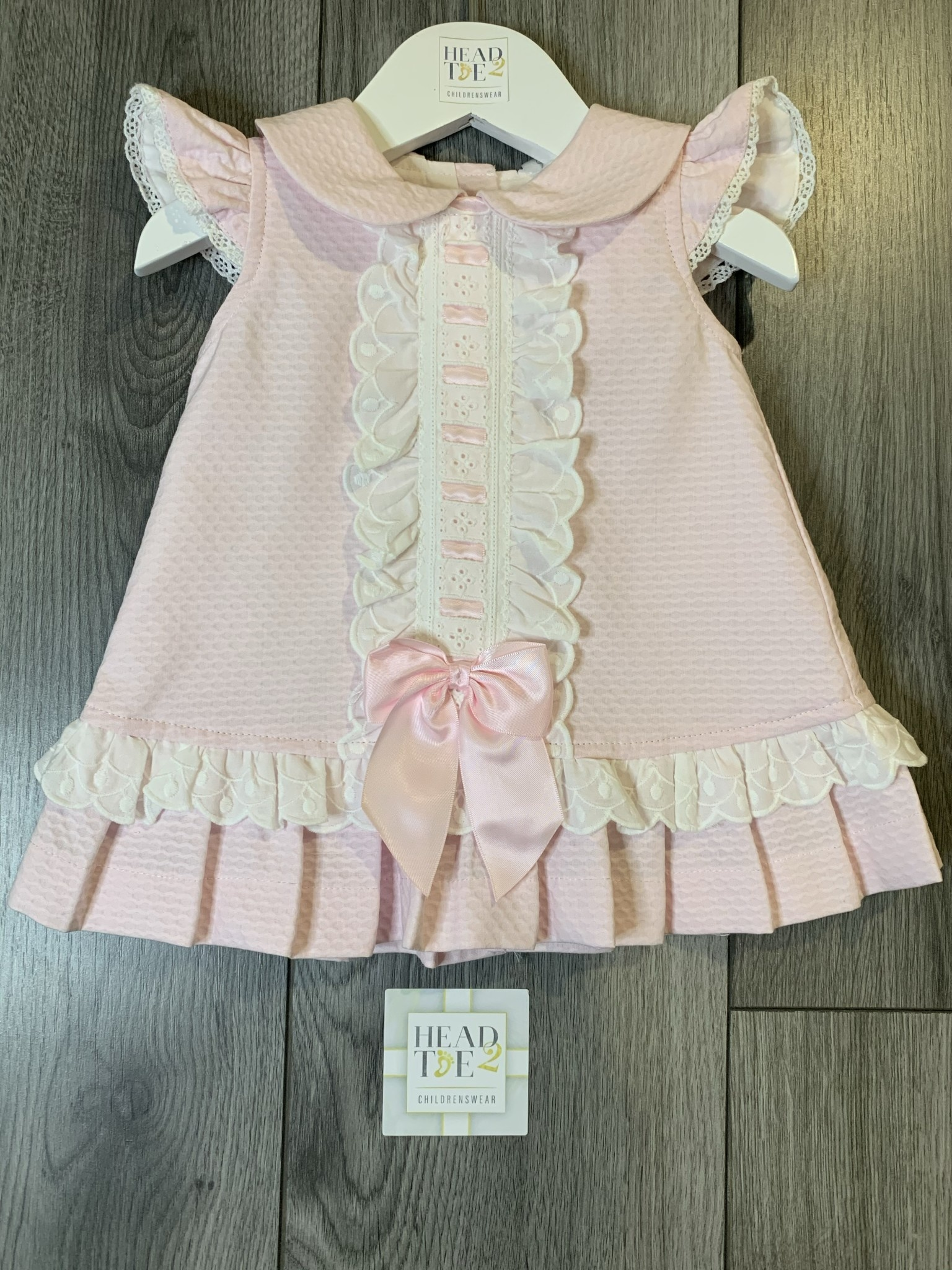 Spanish Pink and White dress with middle bow detail 2030