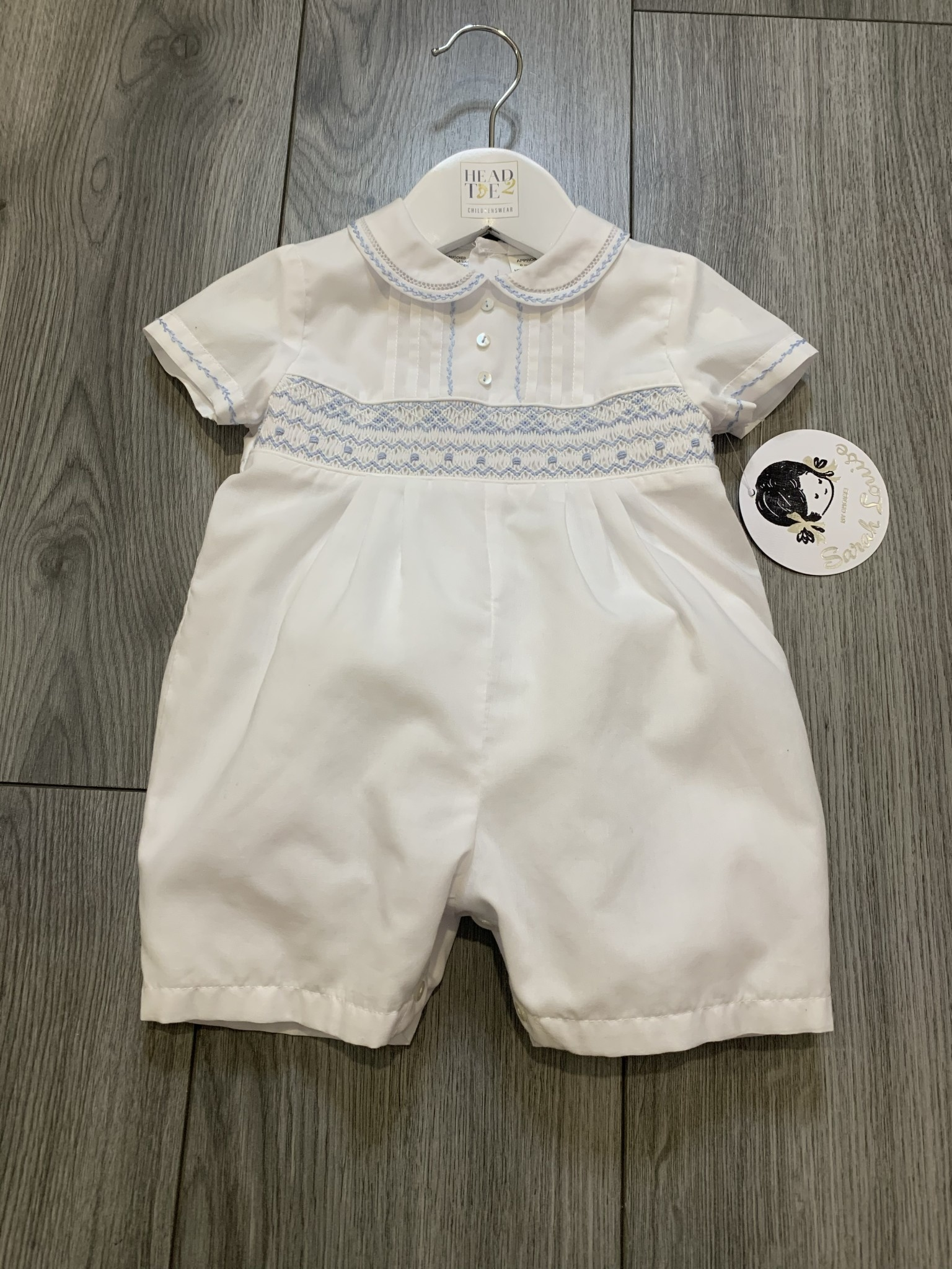 Sarah Louise Sarah Louise SS20 Boys All In One Smocked Romper White/Blue 011855