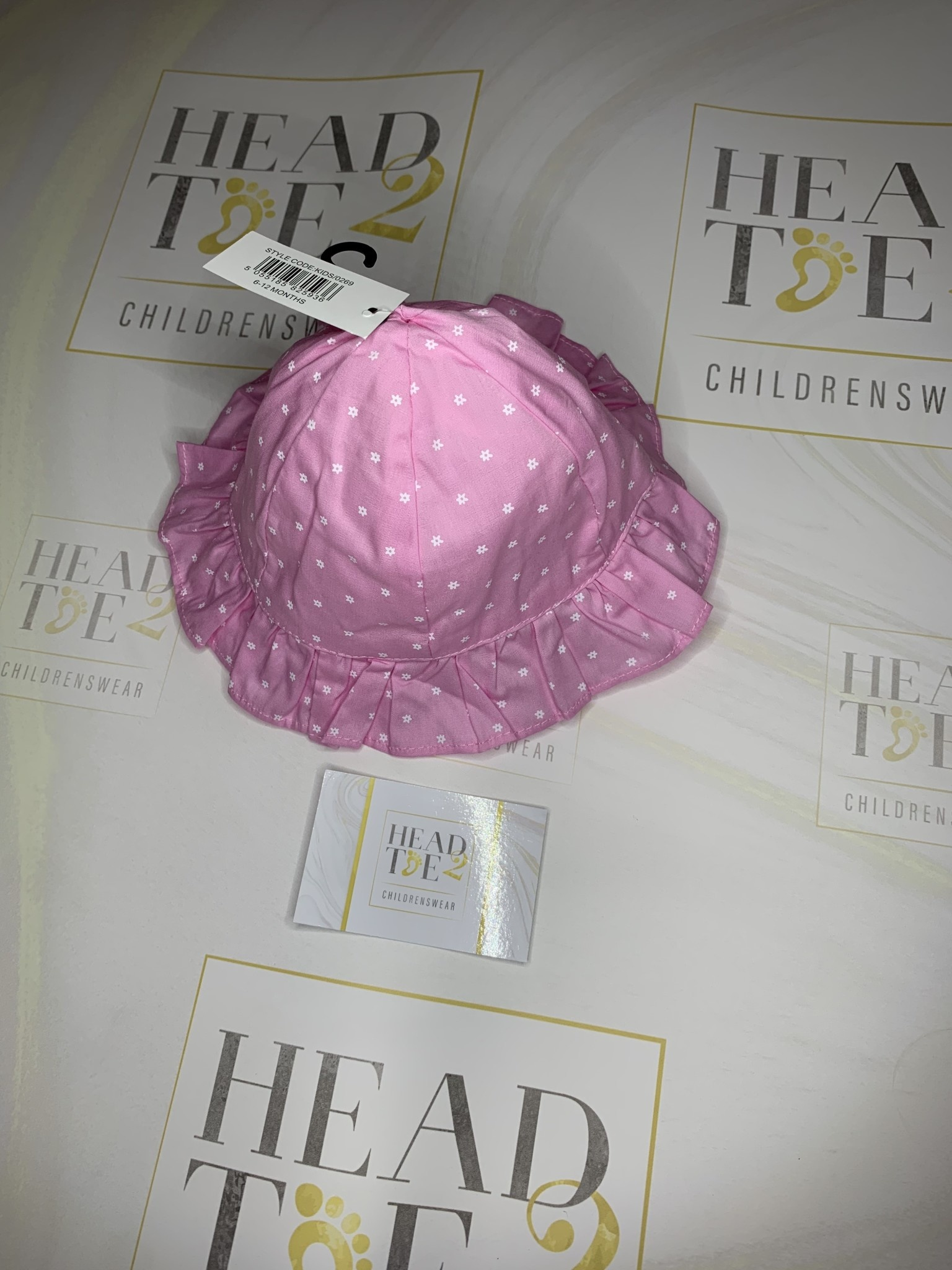 baby girl summer hat with velcro fastening pink with white flower detail size  6-12 months