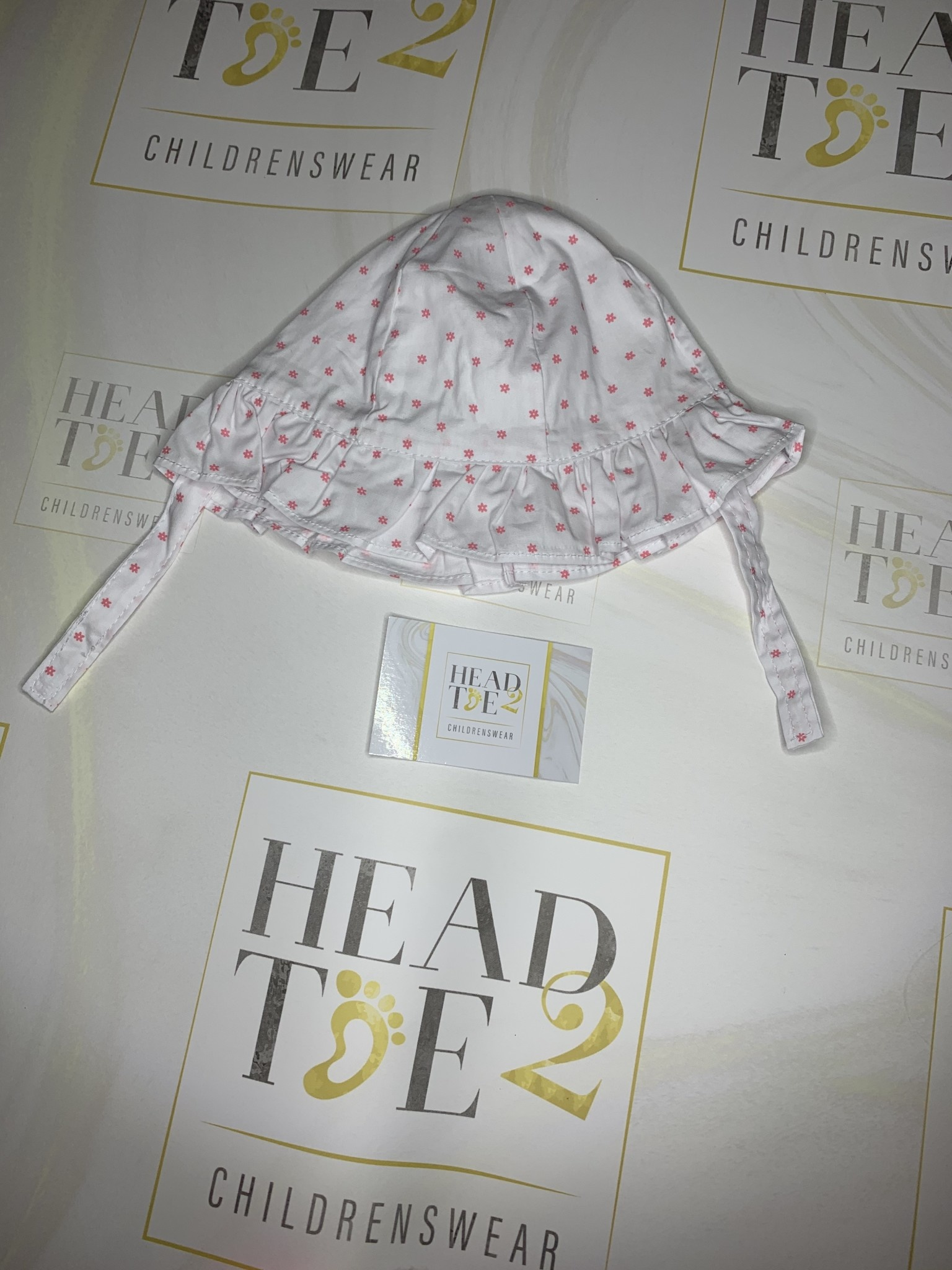 baby girl summer hat with velcro fastening white with pink flower detail