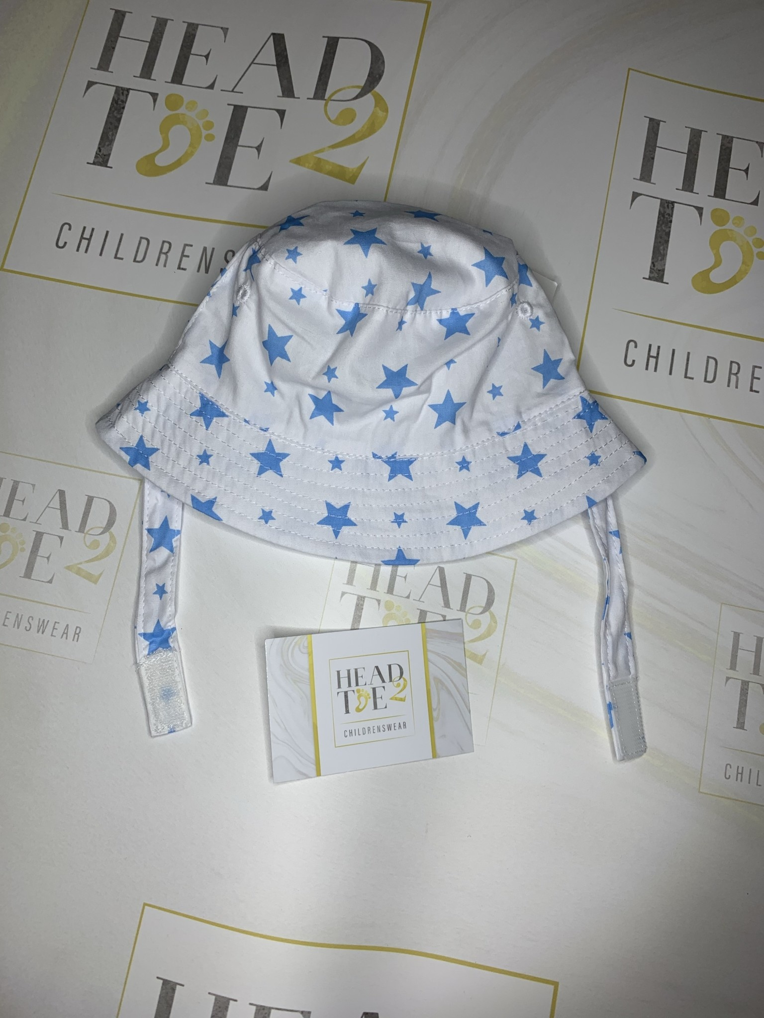 baby boy summer hat with velcro fastening white with blue star detail