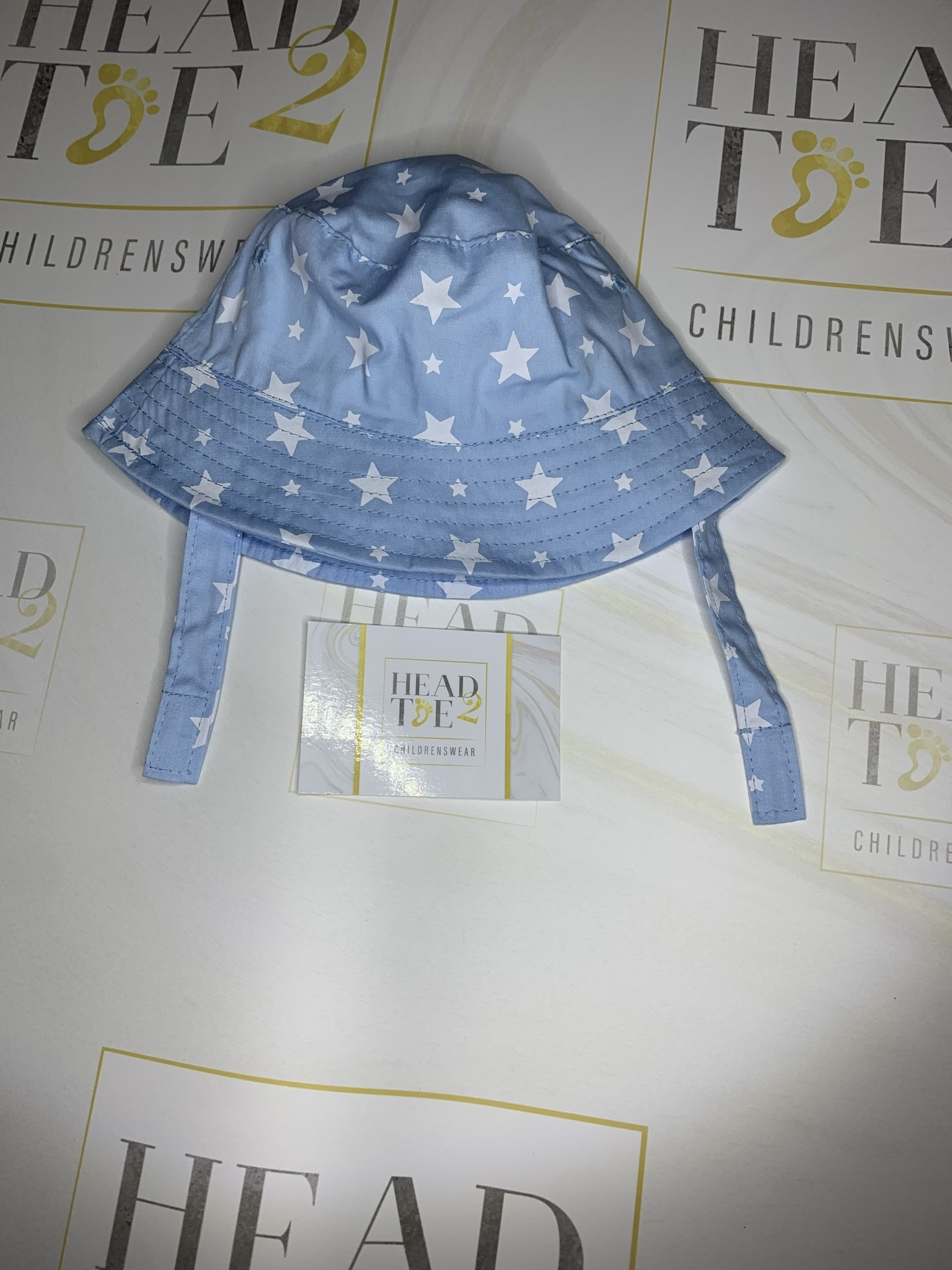 baby boy summer hat with velcro fastening blue with white star detail