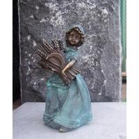 Bild Bronze weiblich mit Maisstängeln