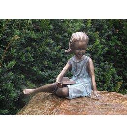 Eliassen Image bronze lying girl with booklet
