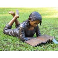 Image bronze lying girl with book