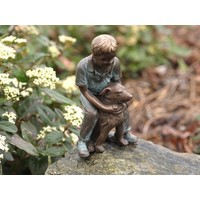 Image bronze boy with dog