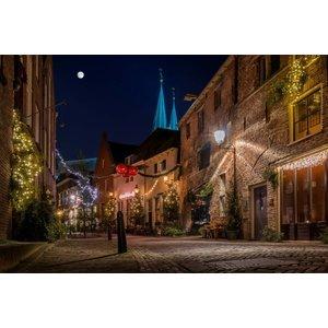 Foto op canvas schilderij stad in de avond