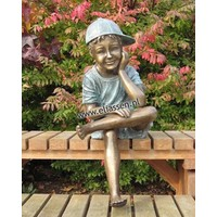 Image bronze sitting boy with cap