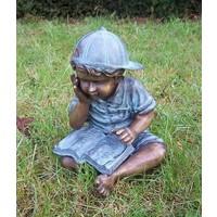 Beeld brons lezende jongen