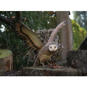 Owl of iron flying away