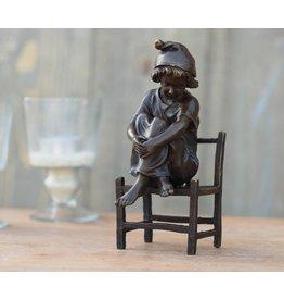 Eliassen Image bronze girl sitting on a chair