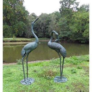 Sculpture bronze scratching heron