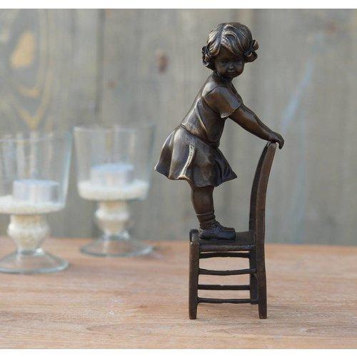 Eliassen Image bronze girl standing on chair
