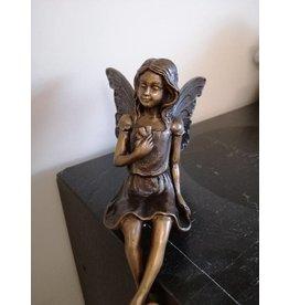 Eliassen fairy with legs over the edge