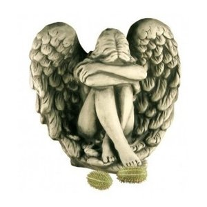 Sculpture stone Angel sitting in wings