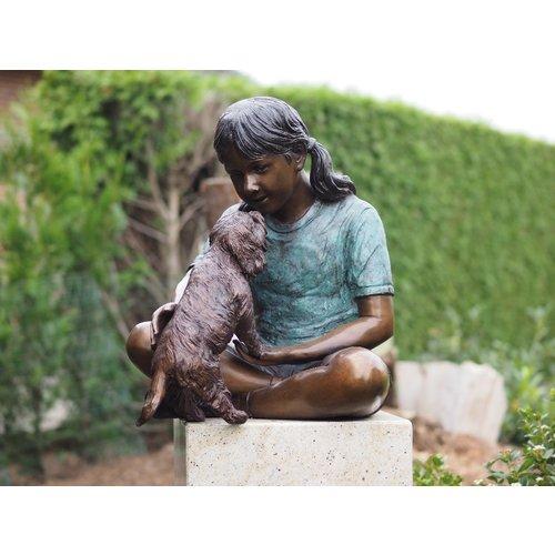 Bronze girl with dog