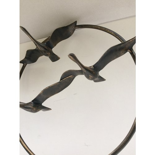 Bronzen zwanen in ring