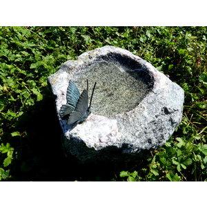Insecten drinkplaats met bronzen vlinder