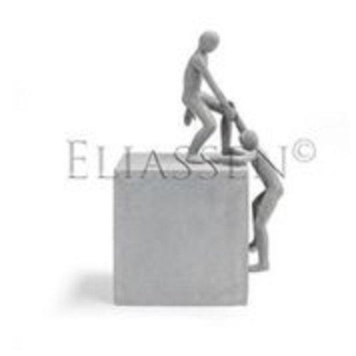Beeld helpende hand op kubus