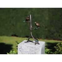 Bronzen musjes op een tak