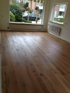 Woonkamer en hal voorzien van eiken houten vloer in Driebergen (7)