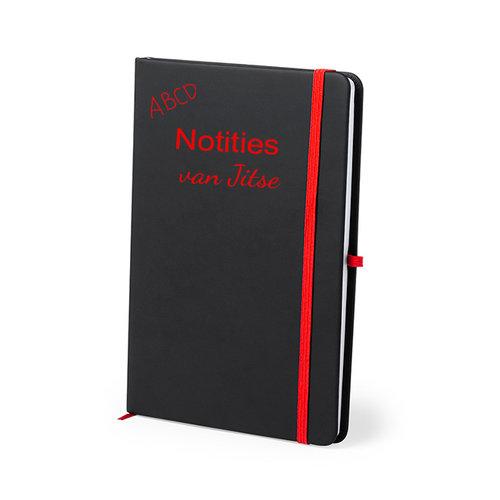 Gegraveerd notitieboekje met tekst en illustratie