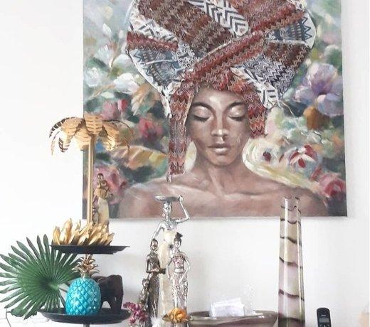Een tropisch tint doe je met een Afrikaanse schilderij