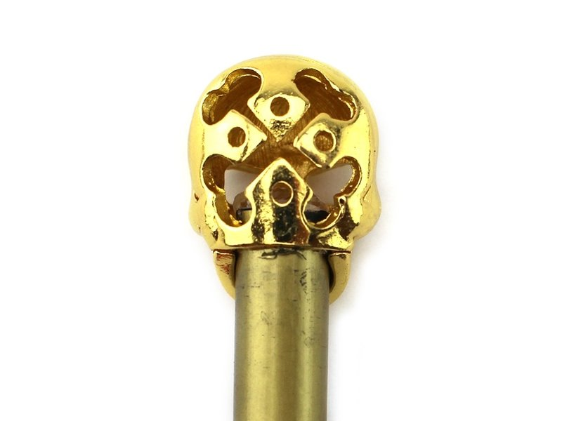 Goldfarbener Bleistift, goldener Schädel
