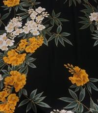 Gele bloem op zwarte ondergrond