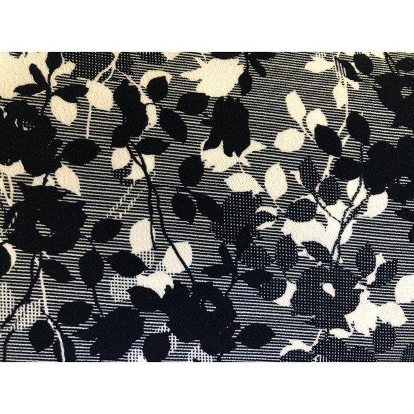 Relief tricot blauw-witte bloem