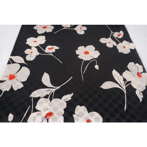 Witte bloem op polka dot