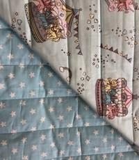 Gewatteerd caroussel / blauw witte sterretjes