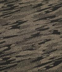 Gebreide stof met vlekpatroon beige/zwart