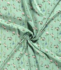 Viscose  stof met bloemetjes mintgroen