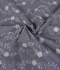 Streepjesstof blauw-wit met bloemetjes