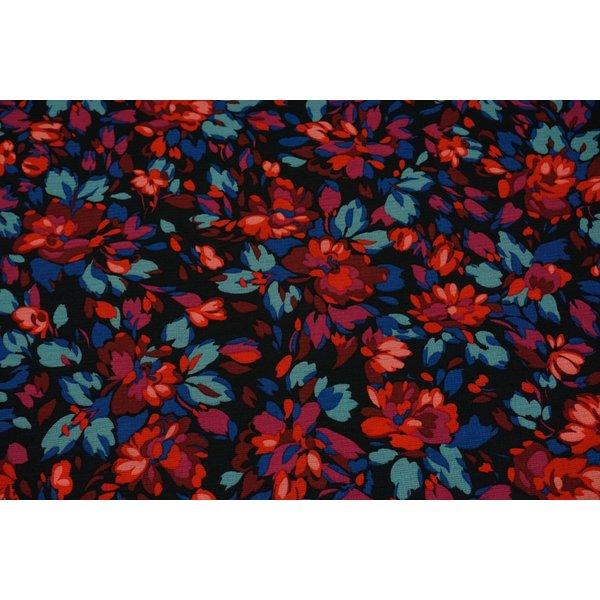 Polytricot stof met vrolijk bloemdessin