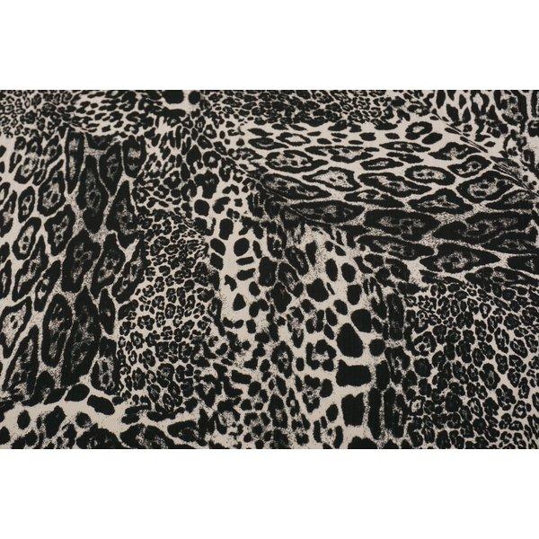 Geribde jersey stof met panterprint zwart-wit