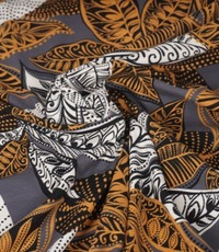 Tricot met Afrikaanse print taupe