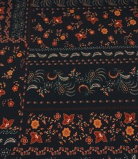 Polyester tricot met bloempaisley