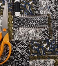 Poly tricot patchwork met groen