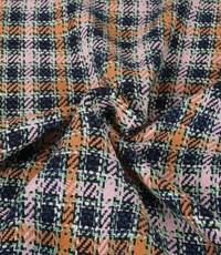 Bouclé ruit in blauw, roze en oranje.