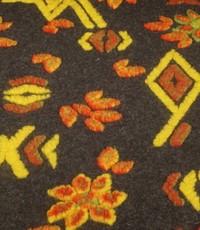 Gekookte wol antraciet grijs met gele en oranje figuren