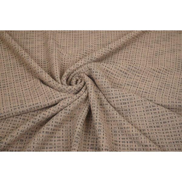 Gebreide stof beige met dunne zwarte lengte draad