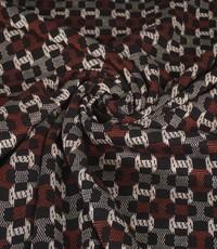 Gebreide stof met fantasiemotiefje in zwart, wit en rood