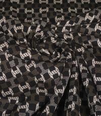 Gebreide stof met fantasiemotiefje in zwart, wit en grijs