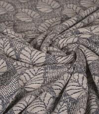 Gebreide stof in ecru met grijs en bladeren