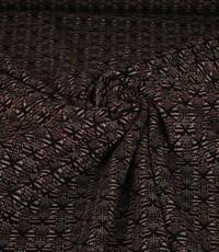 Gebreide zwarte stof met fantasievormen en gouden lurex