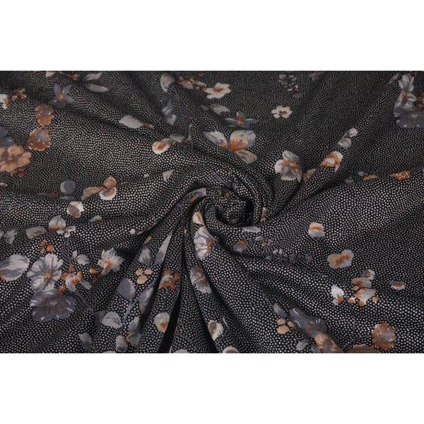 Gebreide stof stipje zwart wit met bloem